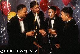 Four men toasting at party